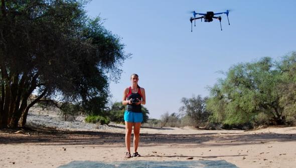 Bryn Morgan flying a drone in the Namib Desert.